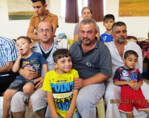 Refugees from Mosul living in a hallway in the village of Howrysk.