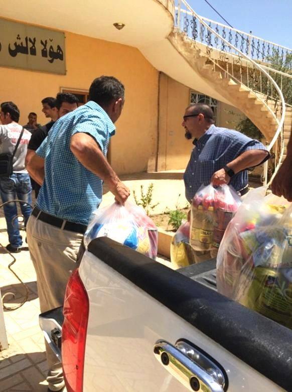 Handing out groceries to the persecuted Christians in Iraq.
